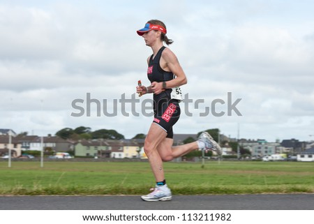 GALWAY, IRELAND - SEPTEMBER 2: Athlete Jennifer Duffy (533) competing at the Course-Run, during 2nd Edition of the Ironman 70.3 Galway 2012 Triathlon, on September 2, 2012 in Galway, Ireland. - stock photo