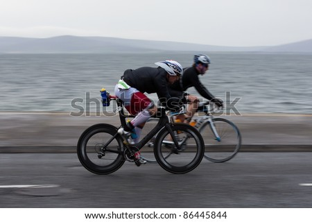 GALWAY - SEPTEMBER 4: Stephen O' Reilly (511) and other athlete compete at first Edition of Galway Iron Man Triathlon on September 4, 2011 in Galway, Ireland - stock photo