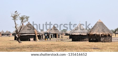 GAMBELA, ETHIOPIA - FEB 9: Villages of the Nuer people in the area of Gambela, close to South Sudan border, typical African huts on Feb 9, 2013 in Gambela, Ethiopia.