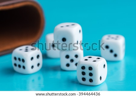 Gamble and taking risk concept - White dices against a blue background - Managing risk - stock photo