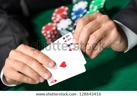 Gambler shows poker cards 4 aces. Risky entertainment of gambling