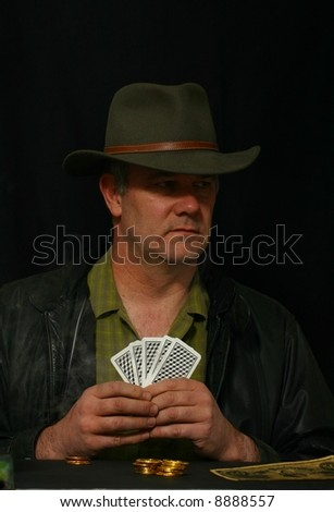 Gambler simply looking to his left - stock photo
