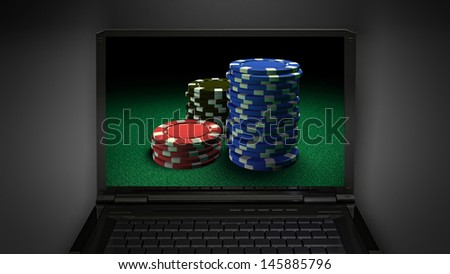 gambling chip theme is display on laptop screen - stock photo