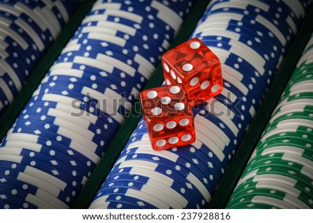 Gambling Chips and Red Dice - stock photo