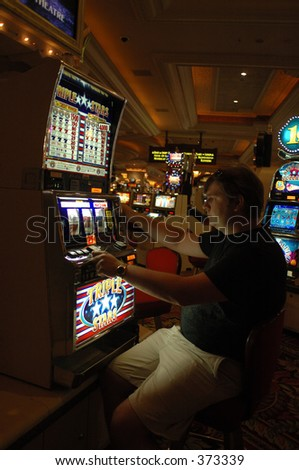 Gambling in Las Vegas casino at slot machine
