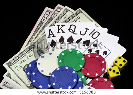 Gambling money, chips, and cards. - stock photo