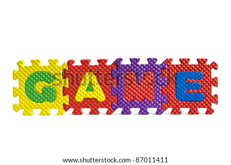 Game concept - sign with alphabet puzzle letters isolated on white background - stock photo