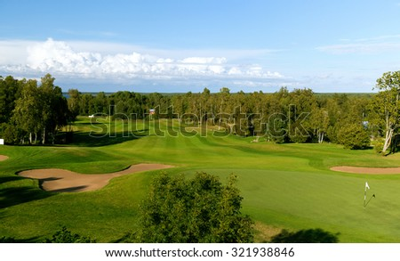 game, entertainment, sport and leisure concept - natural landscape with golf field or course view