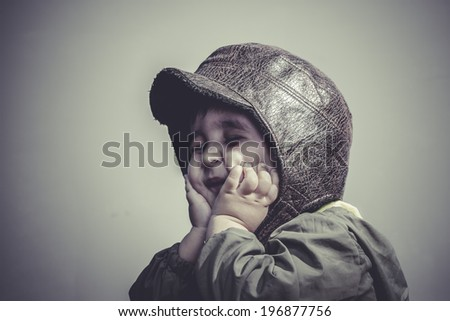 game, fun and funny child dressed in aviator hat and goggles - stock photo