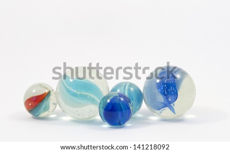 Game marbles in different colors and sizes - stock photo