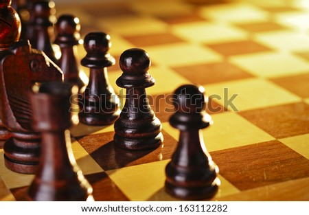 Game of chess with wooden chess pieces lined up on a chessboard for a game of skill, planning and strategy with copyspace - stock photo