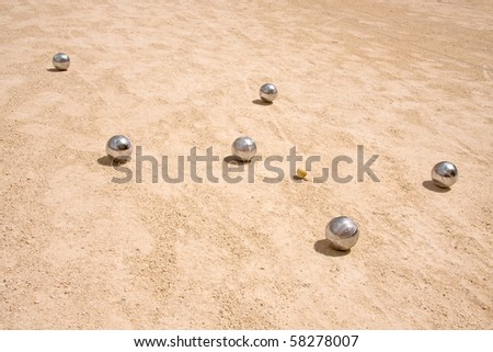 Game of jeu de boule, silvermetal  balls in sand. A french ball game - stock photo