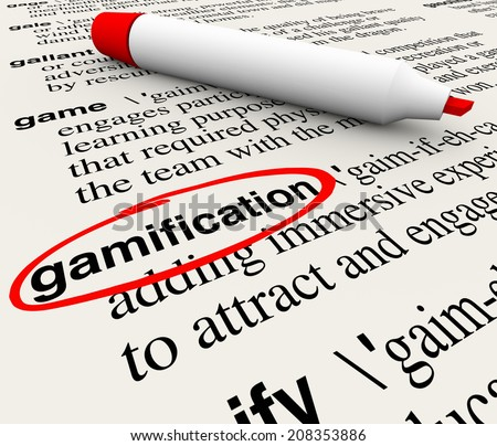 Gamification word circled on a dictionary page with the definition educating you on the term gamify as a way to educate customers and students by making learning or marketing fun