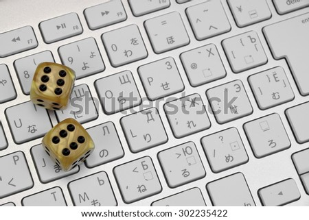 Gaming Dices  On The Computer Keyboard Close-up. Gambling Game Concept - stock photo