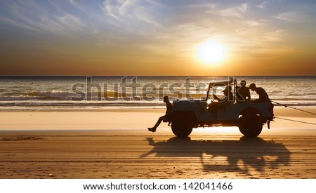 GANAPATIPULE, INDIA - FEBRUARY 10: Tourist attraction Jeep ride at the beach during sunset on Febuary 10, 2012 in Ganapatipule. Ganapatipule is a village with a series of beaches.   - stock photo