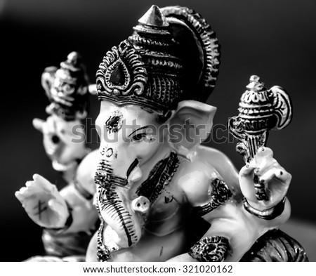 Ganesh (Ganapati- Elephant God) in Hindusim mythology closeup hold the weapons maze and axe pose right side black and white - stock photo