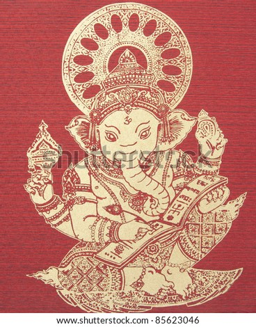 Ganesh, Hindu God on silk - stock photo