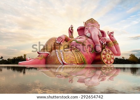 Ganesha, Hindu God and sky with reflect in river - stock photo