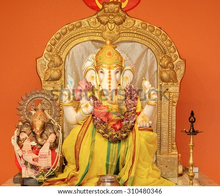 Ganesha idol in Hindu temple. The Lord of Success, son of Shiva and Parvati, destroyer of evils and obstacles. He is also worshiped as the god of education knowledge wisdom and wealth. - stock photo