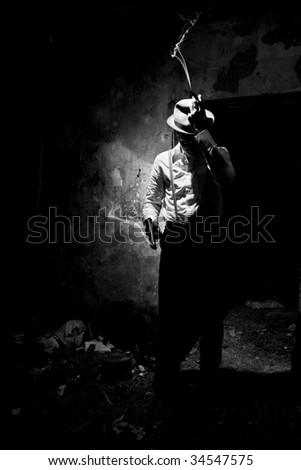 Gangster after action with smoke from cigar and gun - stock photo