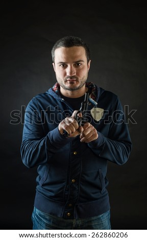 gangster gun reloads on a black background - stock photo
