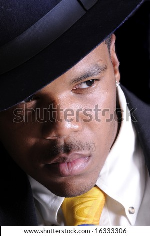 Gangster in a shirt, tie, jacket and fedora. - stock photo