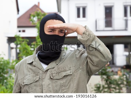Gangster looking for a victim - stock photo
