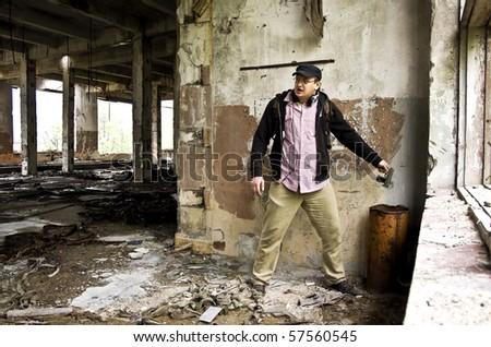 gangster throws away his gun - stock photo