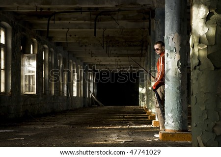 gangster with sword in industrial place - stock photo