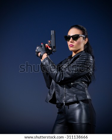 Gangster woman with gun on blue