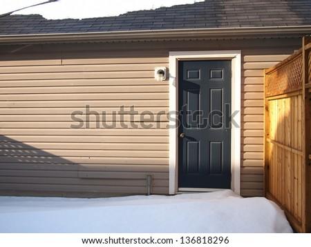 Garage back door in the winter - stock photo