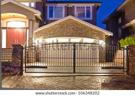 Garage door behind the metal gates at night - stock photo