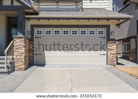 Garage door in a custom built luxury house. - stock photo