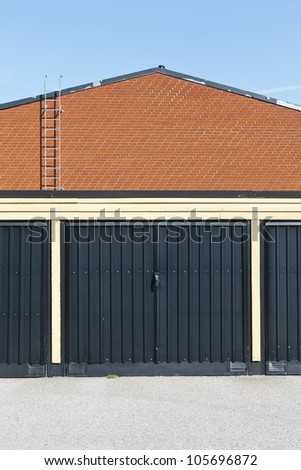 Garage door in front of a brick-wall building