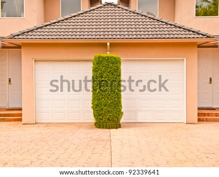 Garage door of a duplex in Vancouver, Canada. - stock photo