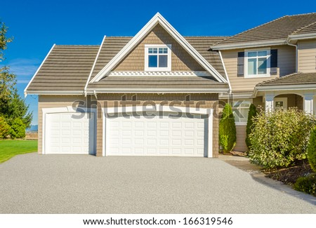 Garage doors of a luxury house in Vancouver, Canada. - stock photo