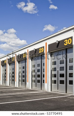 Garage doors on a sunny day - stock photo