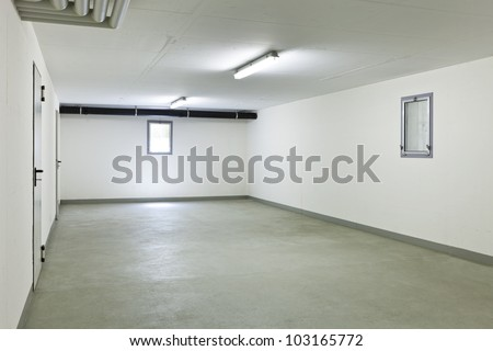 garage of a house without car - stock photo