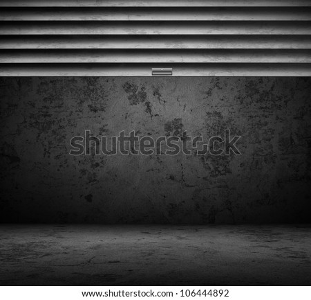 Garage with stainless steel door rolled up - stock photo