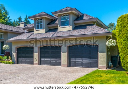 Garage with wide long driveway.