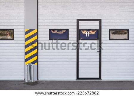 Garages door detail in race circuit. - stock photo
