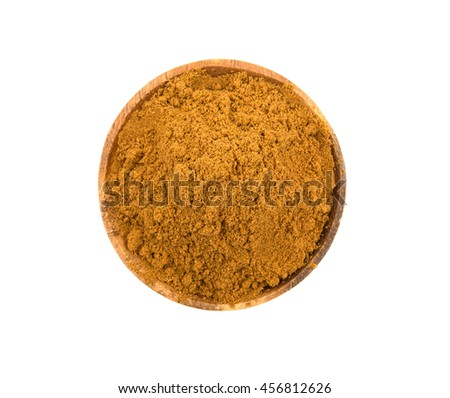 Garam masala or mix spices blend in a wooden bowl over white background