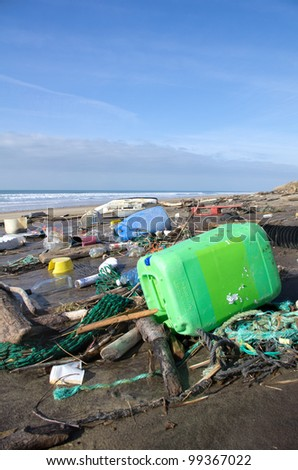 Garbage and waste washed up on a beach - stock photo