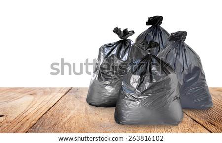 garbage bag on wood  - stock photo