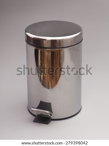 Garbage bin isolated on gray background - stock photo