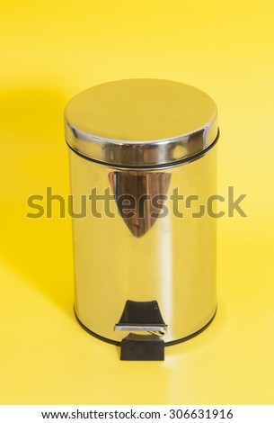 Garbage bin on yellow background