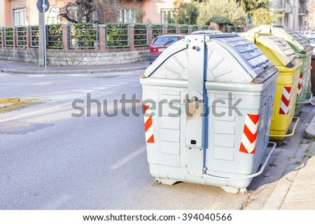 Garbage bins to help separate types of trash and recycle. - stock photo