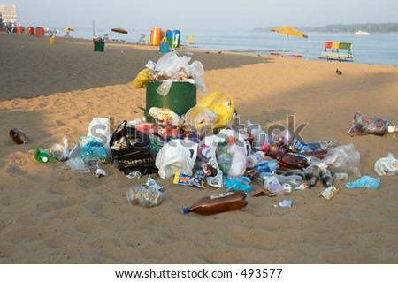 garbage can on the beach - stock photo