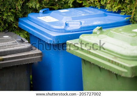 Garbage cans in different colors symbolizing recycling in Germany - stock photo