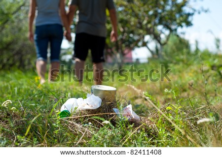 Garbage left in grass. - stock photo